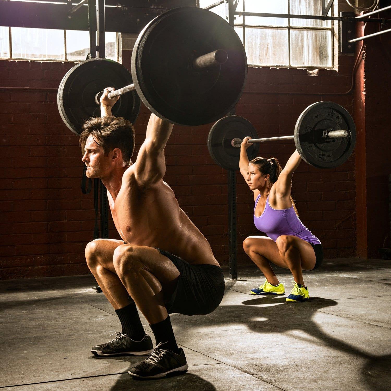 woman-man-lifting-barbells