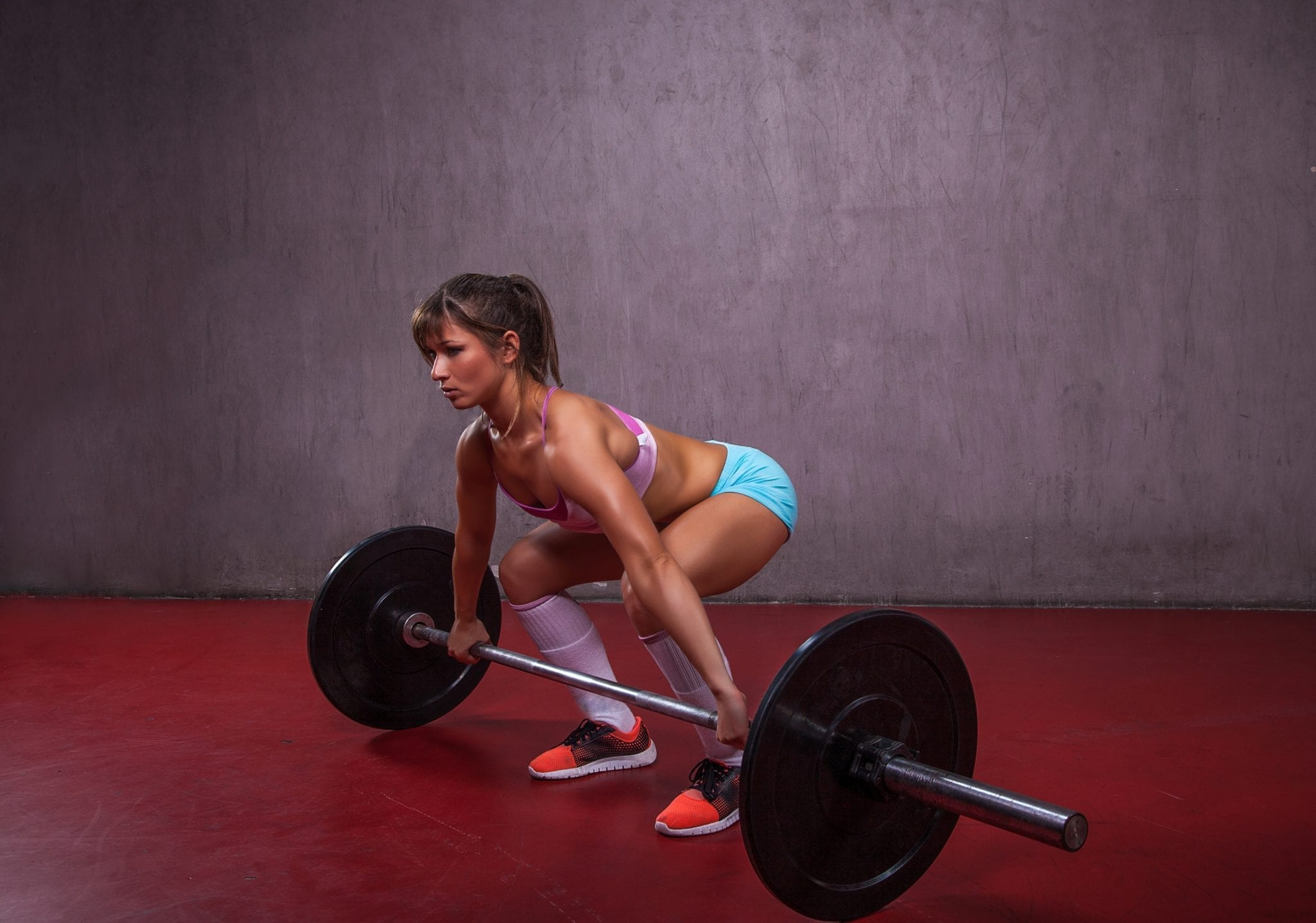 Fit Girl Performing Deadlift